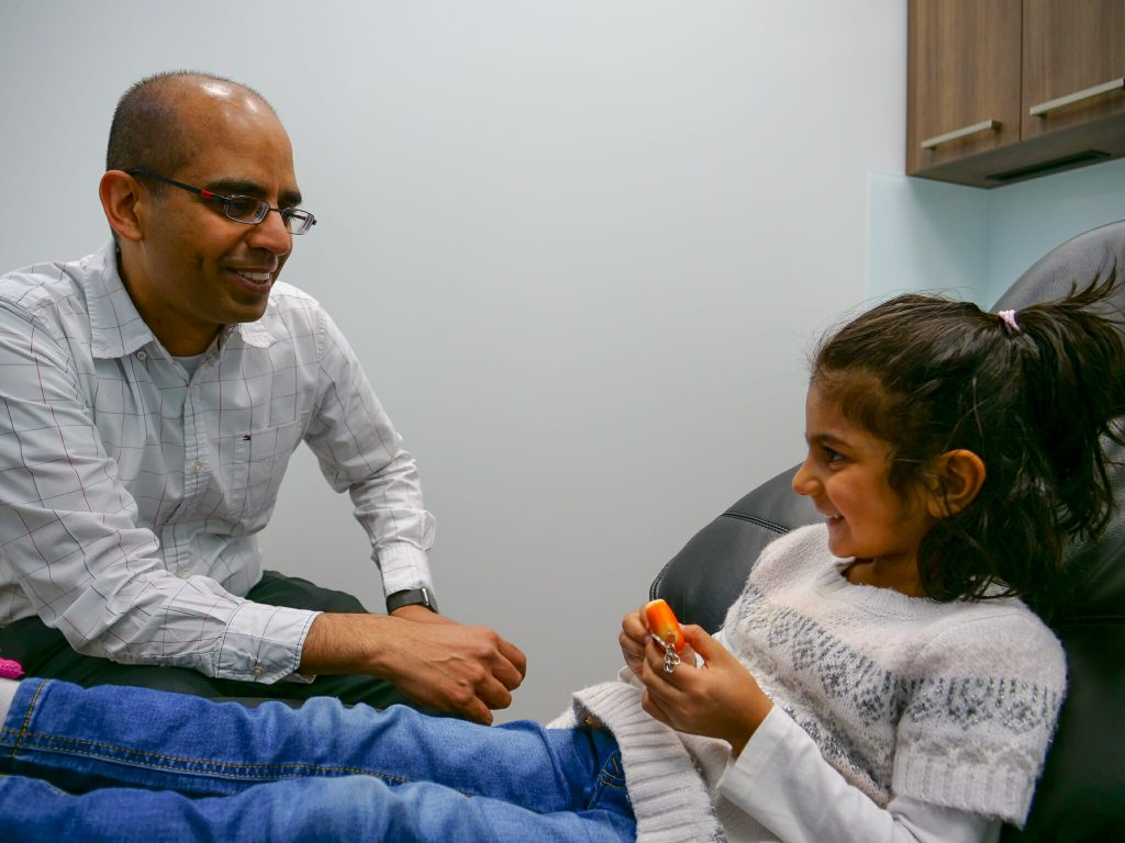 Dr. Jagatjit Dhillon with young patient